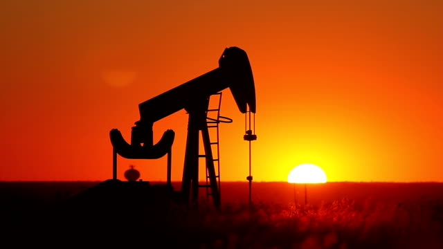 Kansas Oil Pump With Setting Sun