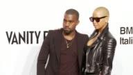 Kanye West Amber Rose at the amfAR's Inaugural Milan Fashion Week Event at Milan