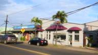 Kapaa Kauai Hawaii downtown village traffic on main street shops Kuhio Highway, 4K