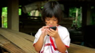 Karen girl is playing and showing Smart Phone