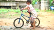 Karen girl poses with her bike