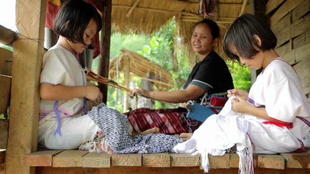 Karen's family is weaving and sewing