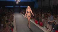 Kate Upton walks the runway during the Beach Bunny swimwear 2012 show at the Beach Bunny Swimwear Runway MBFW Miami Swim 2012 at Miami FL