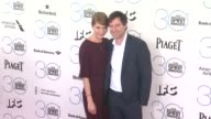 Katie Aselton and Mark Duplass at the 30th Annual Film Independent Spirit Awards Arrivals at Santa Monica Beach on February 21 2015 in Santa Monica...