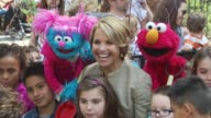 Katie Couric Elmo and participants at the Katie Couric and Sesame Street Muppets When Families Grieve at New York NY