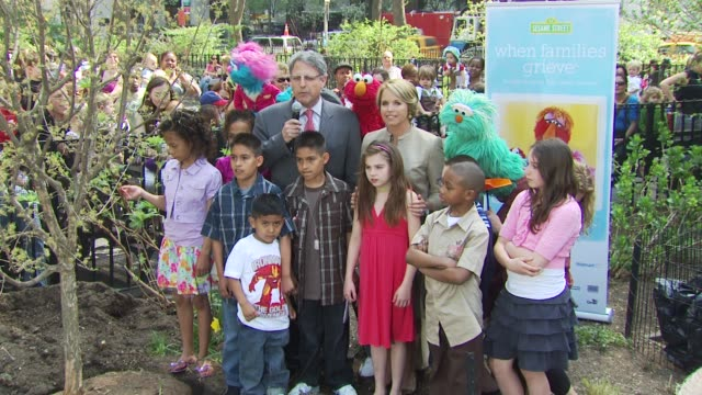 Katie Couric Gary E Knell Elmo and participants at the Katie Couric and Sesame Street Muppets When Families Grieve at New York NY