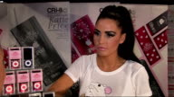 Katie Price launches new range of iPods Various close ups of iPod nano range being launched by Price / Katie Price interview SOT On the 'iPod' outfit...