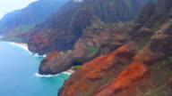Kauai Hawaii aerial of beach and shoreline from helicopter of the breath-taking Na Pali coast canyons cliffs Na Pali-Kona Forest Reserve 4K