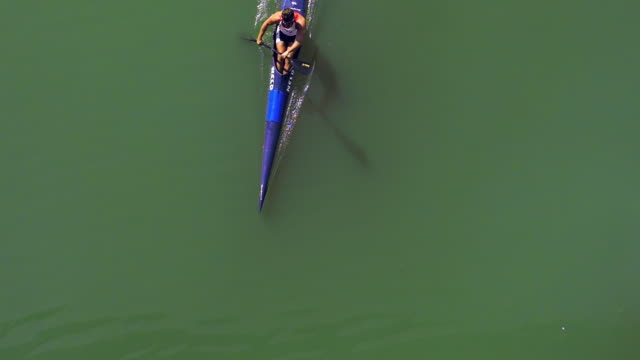 Kayak crossing from above the guafalquivir river in sevilla slowmotion