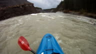 POV of kayaker descends giant waterfall
