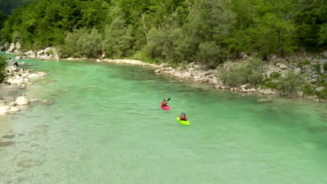 HD: Kayakers Paddling Down The River
