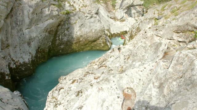 HD: Kayakers Paddling In The Narrow Canyon