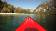 HD TIME-LAPSE: Kayaking along a lake coast.