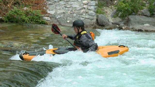 HD SLOW-MOTION: Kayaking on river rapids