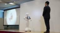 Kazutaka Hasumi product division vice president of SoftBank Robotics Corp demonstrates SoftBank Group Corp's Pepper the humanoid robot during a media...