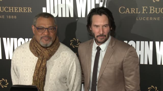 Keanu Reeves and Laurence Fishburne at the 'John Wick Chapter 2' US Premiere at ArcLight Hollywood on January 30 2017 in Hollywood California