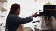 Keeping her coffee machine clean