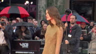 Keira Knightley posing for pictures on red carpet