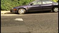 Ken Livingstone condemns road humps Cars along over road hump