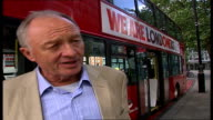 Ken Livingstone initiative to provide free bus travel for 16 and 17yearold students ENGLAND London EXT Two teenage boys boarding a red London bus...