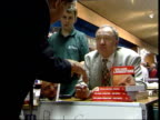 Ken Livingstone signing copies of his autobiography in book signing