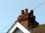 damaged properties in Folkestone ENGLAND Kent Folkestone EXT Earthquakedamaged houses with tiles missing from rooftops and broken chimney stacks /...