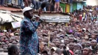 Kenyan opposition leader Raila Odinga addresses his supporters in Mathare North where he visited the parents of a 8yearold girl killed by a stray...