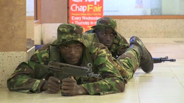 Kenyan police backed by special forces battle Somali gunmen who stormed an upscale shopping mall in Nairobi killing more than 50 people and taking...