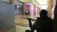 Kenyan police backed by special forces continue to battle gunmen who stormed an upscale shopping mall in Nairobi killing at least 20 people and...