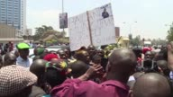 Kenyan police use tear gas to disperse opposition protesters outside the headquarters of the election commission a month before a scheduled doover of...