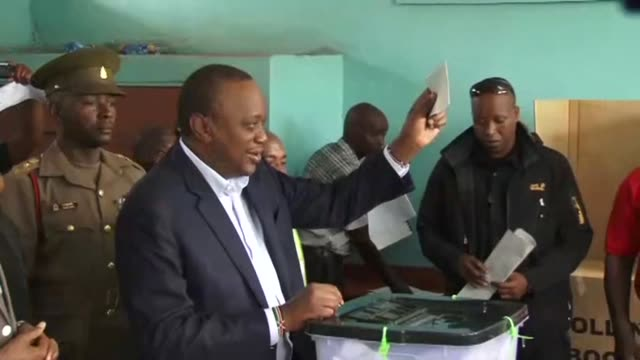 Kenyan Presidnet Uhuru Kenyatta casts his vote in Gatundu during a repeat election that has polarised the nation and is likely to be fiercely...