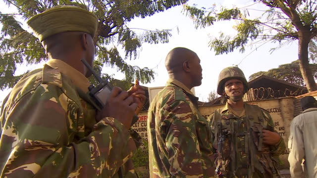 Kenyan soldiers standing guard at a polling booth as votes are counted in the Presidential election