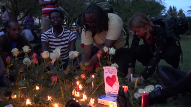 Kenyans attend a candle light vigil late Tuesday at Uhuru park in capital Nairobi in memory of the people killed in last week's deadly attack on...