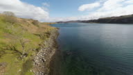 Kerrera island Scotland, aerial view of valley, coastline and Oban in the background