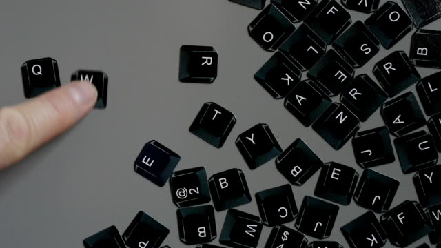 Keyboard fridge magnets spellimg QWERTY