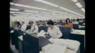 Keypuch operators HA PAN Open office w/ rows of desks CU Male worker CU Punch card in machine VS Woman working w/ accounting machines keypunch...