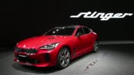 A Kia Stinger Sedan on display during the Seoul Motor Show in Seoul South Korea on March 31 2017 Shots full generic views of red Stinger vehicle with...