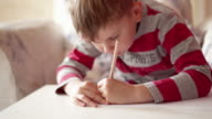 Kid drawing on paper sheet