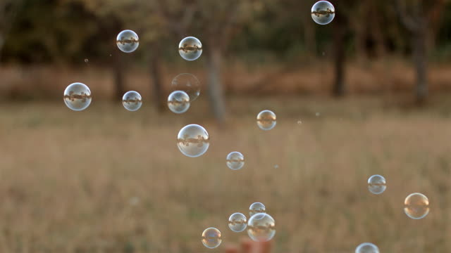 Kid of Two chasing soap bubbles