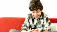 Kid playing games or texting on mobile phone