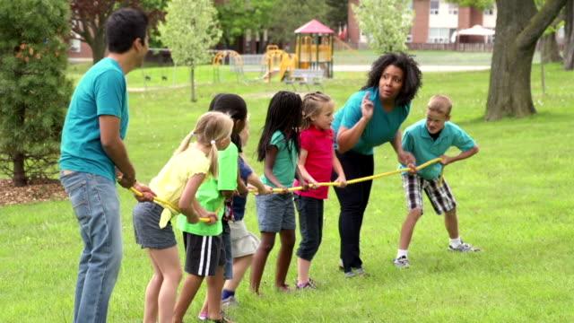 Kids and Camp Counselors Tug Of War