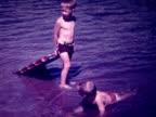 1938 kids and dad swim in lake
