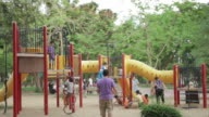 kids and parents at park playground