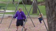 Kids Being Pushed On Swing Set on October 21 2013 in Dallas Texas