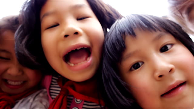 kids close up to camera