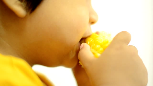 Kids eat corn