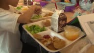 WGN Kids eating lunch in a school cafeteria at Federico Garcia Lorca Elementary on Aug 2 2014 in Chicago