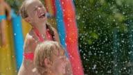 SLO MO Kids enjoying splashing water on a hot day