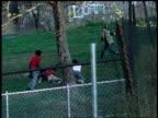 1982 WS Kids playing football / Bronx, New York City, New York, United States