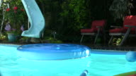 Kids playing in the swimming pool with foam floats.